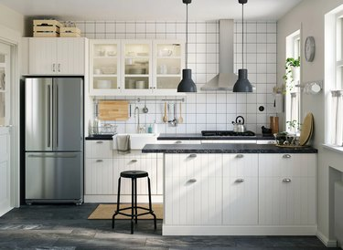kitchen with white cabinets with boxes atop them