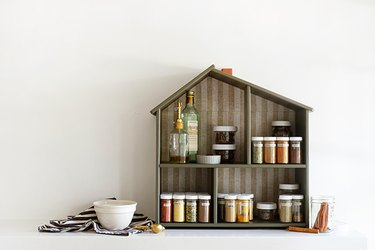 IKEA hack: Turn a dollhouse into a spice rack for your kitchen.