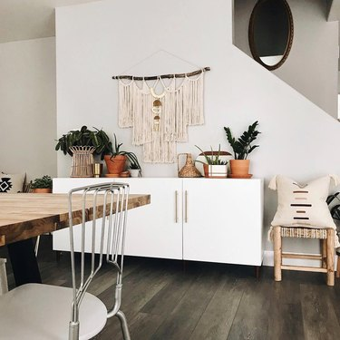 bohemian dining room with white buffet for storage