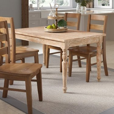 Shaker style farmhouse table idea with chairs near kitchen