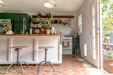 kitchen with tiled floor and white island