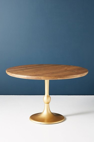 round wood and gold dining table