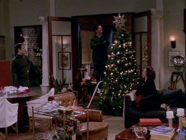 scene from Will & Grace showing figures around a Christmas tree