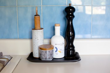focus on salt and pepper shakers in kitchen with blue tile