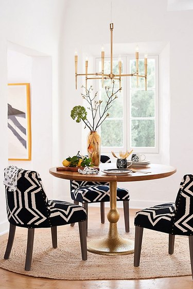 small round dining table with black and white accent chairs