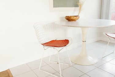 white tile floor in kitchen, tulip table, bertoia chairs
