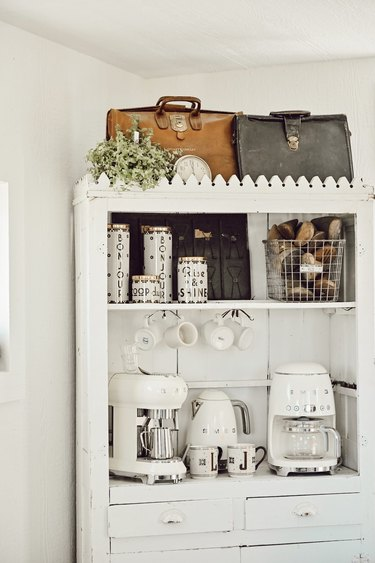 Farmhouse coffee bar with vintage accents and white small appliances