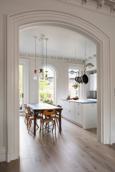 Pendant lights over dining table in kitchen.