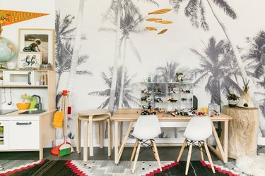 An accent wall of palm trees, in black and white, is 100% California cool in this playroom.