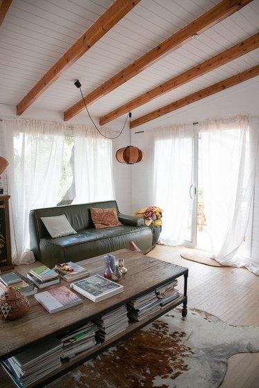 Wood pendant lamp in boho living room.
