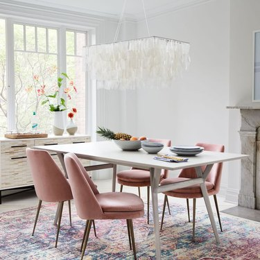 coastal dining room lighting with capiz chandelier over table