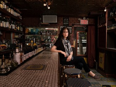 """Kara Newman, the author of """"Nightcap,"""" at the East Village bar Amor y Amargo."""