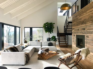 rustic living room idea with wood fireplace and sectional sofa