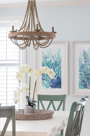 coastal dining room lighting with beaded chandelier above table