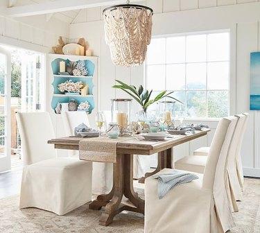 coastal dining room lighting with Pottery Barn amelia wood bead chandelier