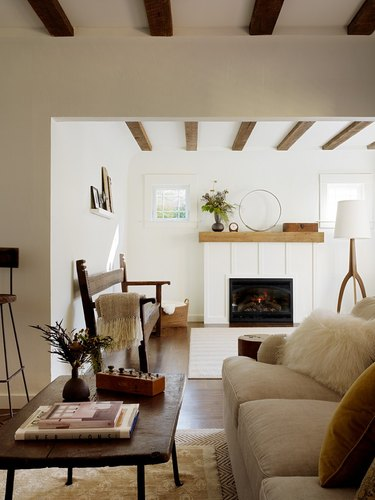 rustic living room idea with exposed ceiling beams