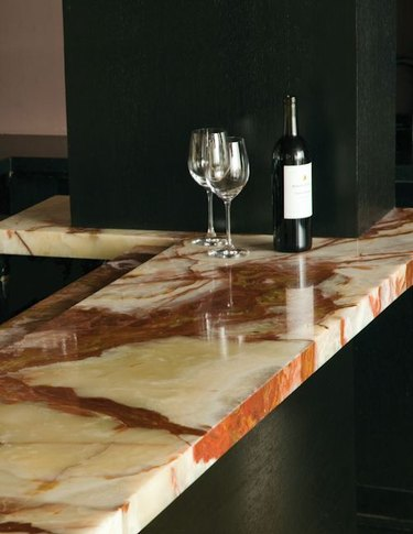 onyx countertop in kitchen with wine glasses