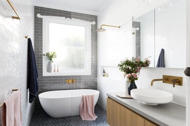 shower window idea with freestanding bath in modern gray and white bathroom
