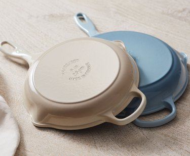 off-white and light blue cast iron skillets
