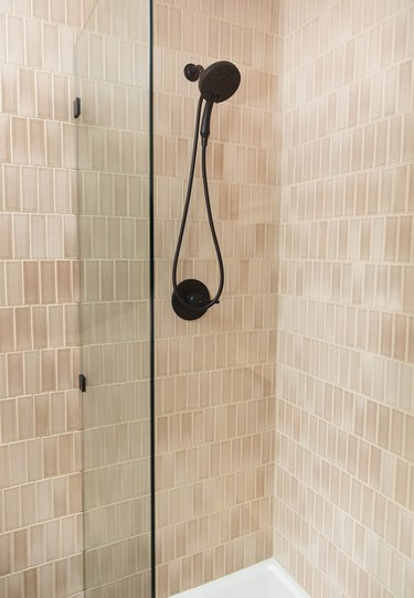 nude pink subway tile shower idea with matte black shower