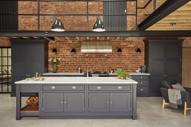 exposed brick backsplash in modern warehouse kitchen