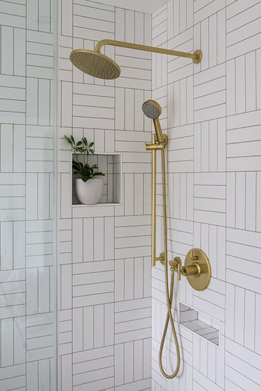 white subway tile shower idea in a crosshatch pattern