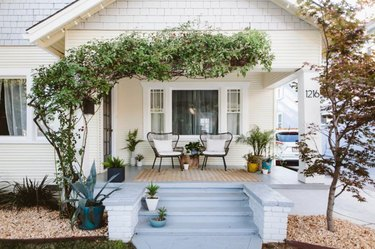 petite farmhouse porch idea with seating for two