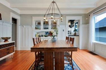 dining room with wood floors and table, with chandelier