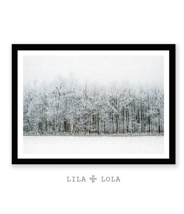 Black-and-white print of snowy woodland scene