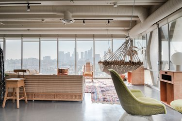 open loft with view of downtown, concrete floors, hammock