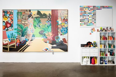 focus on colorful painting with cubbies to the side and concrete floor
