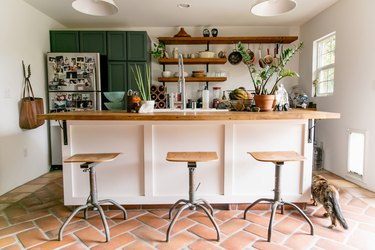 kitchen space with three stools in the front