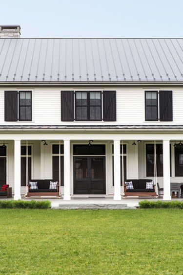 farmhouse porch idea with hanging sofas