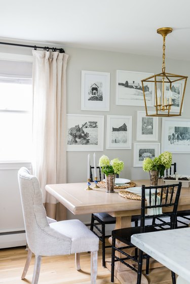 dining room with craftsman style lighting fixture, wood table, and mixed style chairs