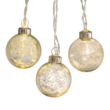 silver and gold globe string lights