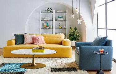 living room with yellow and blue couches
