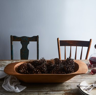 farmhouse table centerpiece idea with wood Bowl from Food52 Filled with Pinecones