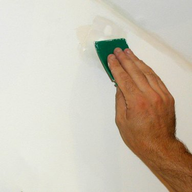 Sanding spackled wall