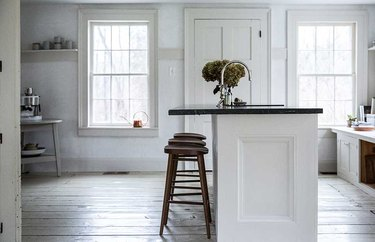 farmhouse flooring idea in kitchen with white painted floors