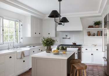 farmhouse flooring idea in neutral kitchen with terra cotta floors