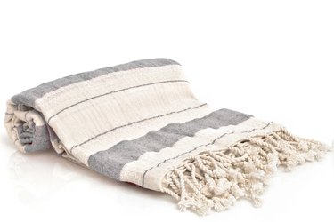 Cream and light denim blue striped towel with fringe