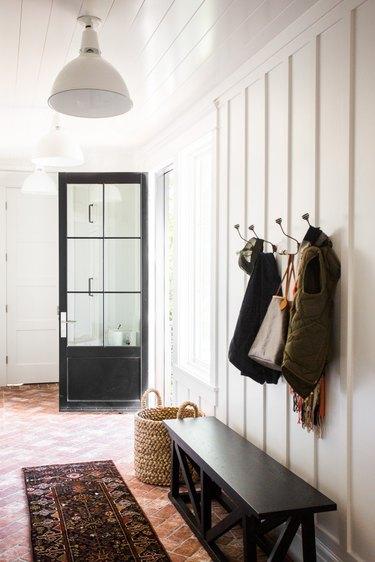 farmhouse flooring idea in mudroom with brick floors