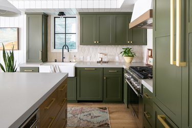 olive green kitchen color idea with green cabinets and farmhouse sink