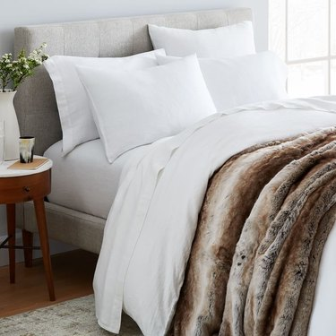 farmhouse bedding idea from West Elm with Belgian linen and faux fur