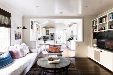 living room with entertainment center and white couch