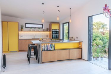 Minimal Scandinavian yellow kitchen color idea with wood cabinets