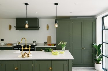 white and olive green kitchen color idea with gold accents