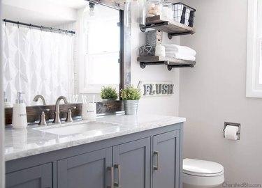 small farmhouse bathroom idea with gray cabinets and rustic mirror