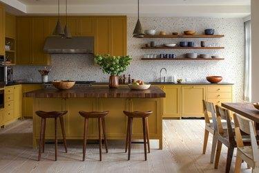 Warm yellow kitchen color idea with patterned tile backsplash.