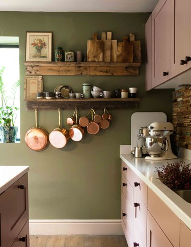 olive green kitchen color idea with green wall and pink cabinets